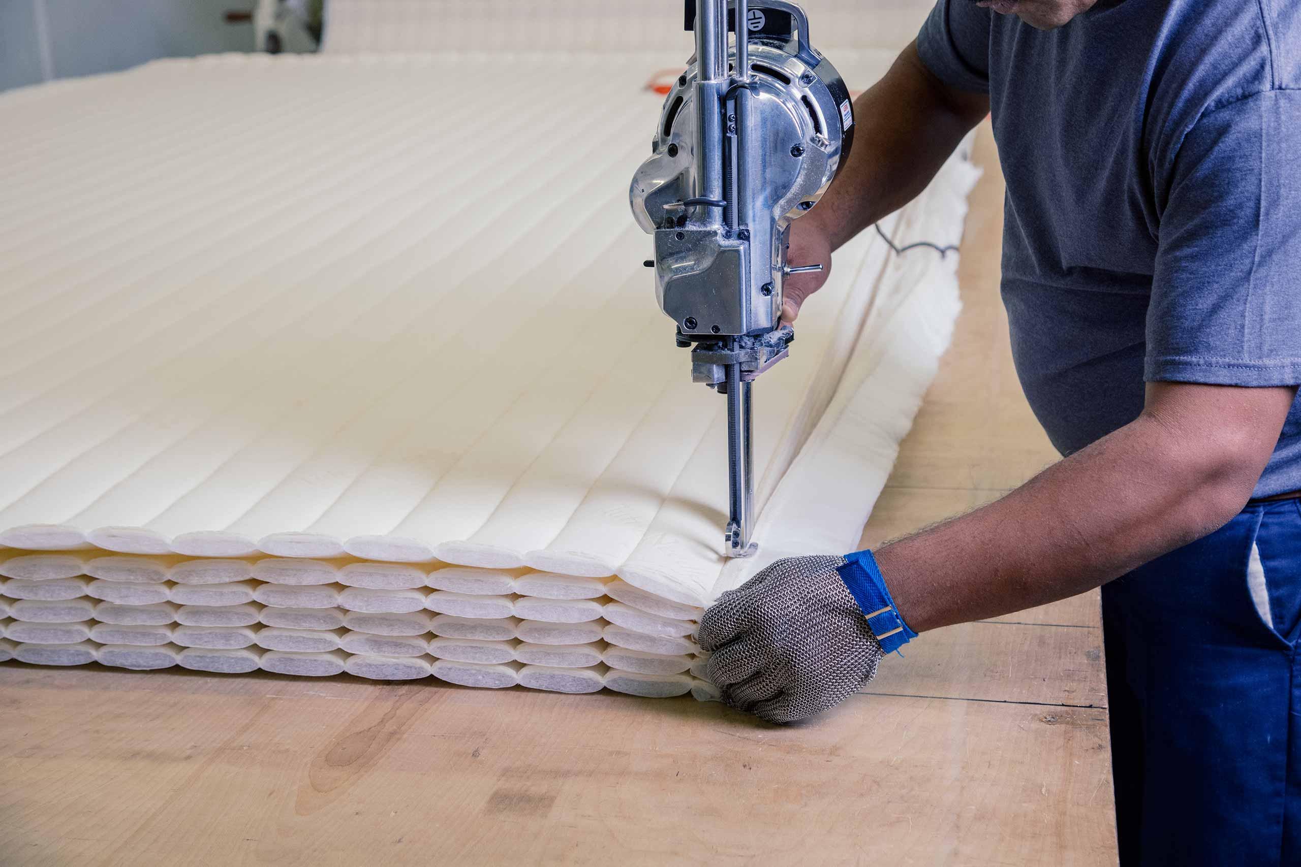 Tuft & Needle employee making a mattress